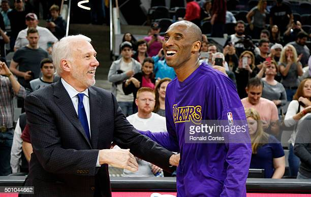 Kobe Bryant of the Los Angeles Lakers talks with head coach Gregg Popovich of the San Antonio Spurs at the end of the game at ATT Center on December...