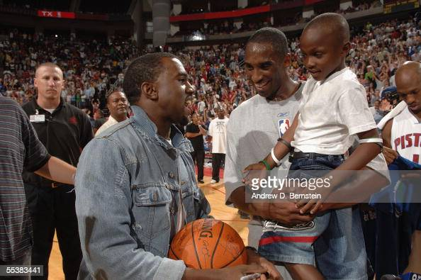 Kobe Bryant of the Los Angeles Lakers talks with HipHop artist Kanye West on the court following Kenny Smith's Hurricane Katrina Relief NBA Charity...
