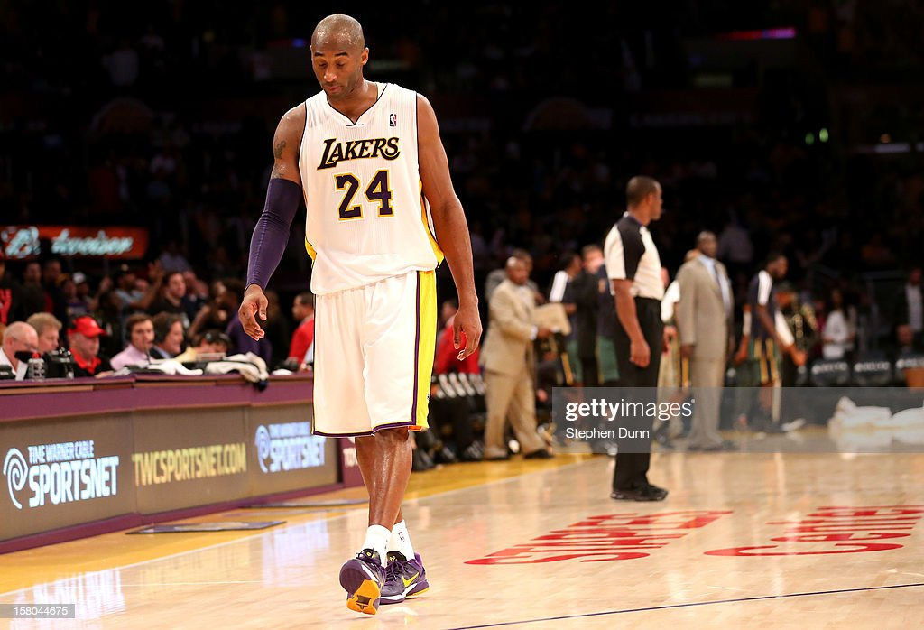 Kobe Bryant #24 of the Los Angeles Lakers walks off the court after the game against the Utah Jazz at Staples Center on December 9, 2012 in Los Angeles, California. The Jazz won 117-110.