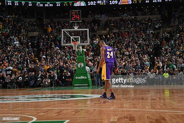 Kobe Bryant of the Los Angeles Lakers walks off the court in Boston one last after the game against the Boston Celtics on December 30 2015 at the TD...