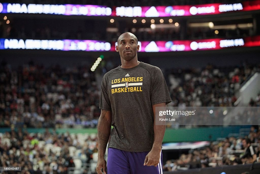 <a gi-track='captionPersonalityLinkClicked' href=/galleries/search?phrase=Kobe+Bryant&family=editorial&specificpeople=201466 ng-click='$event.stopPropagation()'>Kobe Bryant</a> of the Los Angeles Lakers walks on the court at NBA Fans Appreciation day on October 17, 2013 in Shanghai, China.