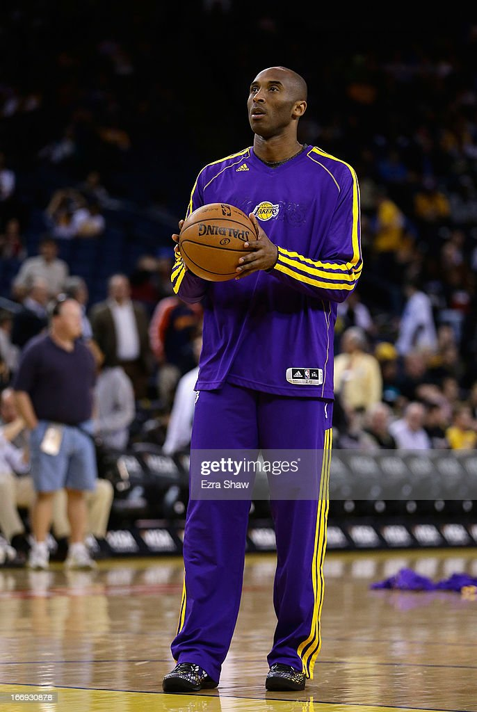 Kobe Bryant #24 of the Los Angeles Lakers warms up before their game against the Golden State Warriors at Oracle Arena on March 25, 2013 in Oakland, California.