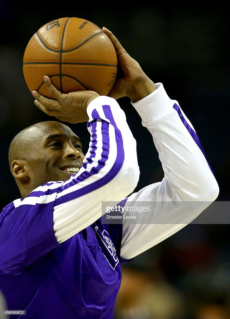<a gi-track='captionPersonalityLinkClicked' href=/galleries/search?phrase=Kobe+Bryant&family=editorial&specificpeople=201466 ng-click='$event.stopPropagation()'>Kobe Bryant</a> #24 of the Los Angeles Lakers warms up before their game against the Charlotte Bobcats at Time Warner Cable Arena on December 14, 2013 in Charlotte, North Carolina.