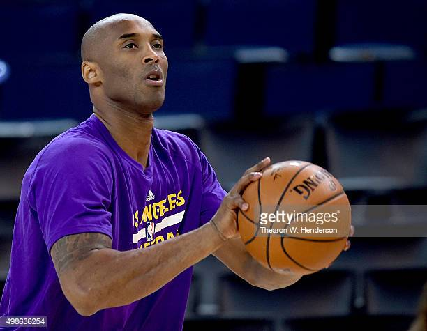 Kobe Bryant of the Los Angeles Lakers warms up prior to playing the Golden State Warriors in an NBA basketball game at ORACLE Arena on November 24...
