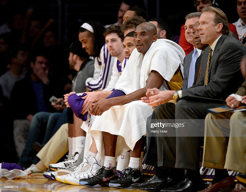 <a gi-track='captionPersonalityLinkClicked' href=/galleries/search?phrase=Kobe+Bryant&family=editorial&specificpeople=201466 ng-click='$event.stopPropagation()'>Kobe Bryant</a> #24 of the Los Angeles Lakers watches play from the bench during a 116-94 loss to the Toronto Raptors at Staples Center on December 8, 2013 in Los Angeles, California.