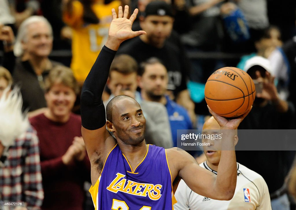 Kobe Bryant #24 of the Los Angeles Lakers waves to the crowd after passing Michael Jordan on the all-time scoring list with a free throw in the second quarter of the game on December 14, 2014 at Target Center in Minneapolis, Minnesota.
