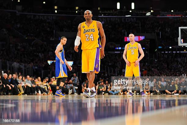 Kobe Bryant of the Los Angeles Lakers winces before shooting a freethrow during a game against the Golden State Warriors at Staples Center on April...