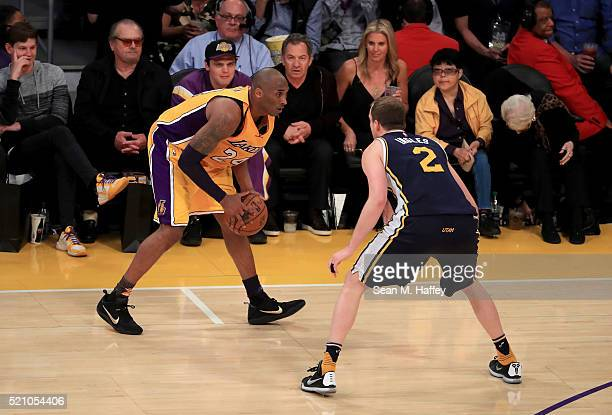 Kobe Bryant of the Los Angeles Lakers with the ball against Joe Ingles of the Utah Jazz in the second half at Staples Center on April 13 2016 in Los...