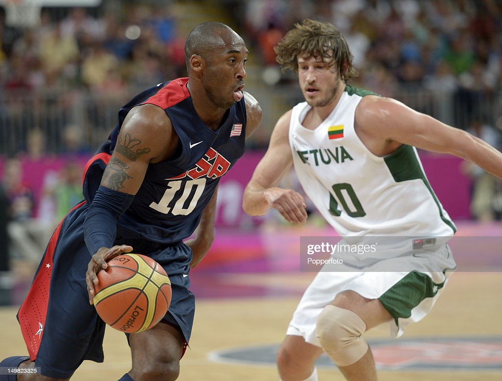 <a gi-track='captionPersonalityLinkClicked' href=/galleries/search?phrase=Kobe+Bryant&family=editorial&specificpeople=201466 ng-click='$event.stopPropagation()'>Kobe Bryant</a> of the United States with Simas Jasaitas of Lithuania during the Men's Basketball Preliminary Round match United States v Lithuania on Day 8 of the London 2012 Olympic Games at the Basketball Arena on August 4, 2012 in London, England.