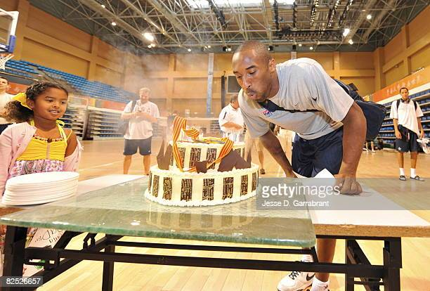 Kobe Bryant of the US Men's Senior National Team blows out his birthday cake during practice at the 2008 Beijing Summer Olympics on August 23 2008 at...