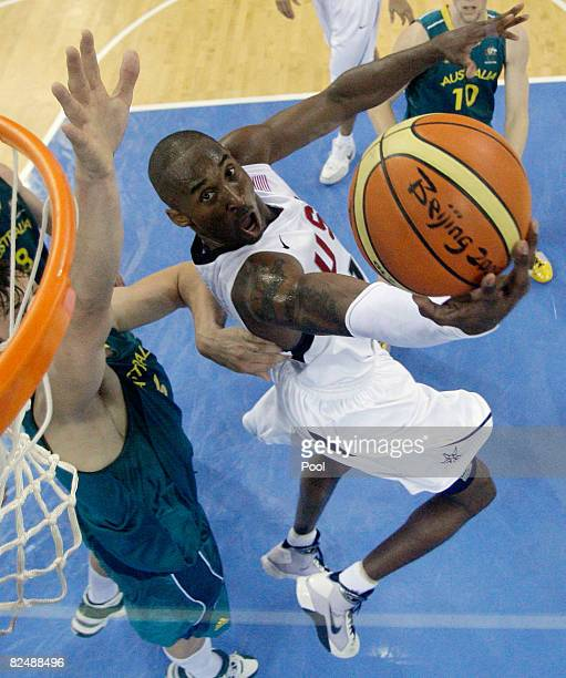 Kobe Bryant of the USA shoots as Andrew Bogut of Australia defends during the Men's Basketball Quarterfinal game at the Olympic Basketball Gymnasium...