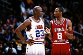 Kobe Bryant of the Western Conference All Stars talks with Michael Jordan of the Eastern conference All Stars during the 2003 NBA AllStar Game at the...