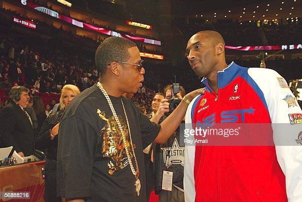 Kobe Bryant of the Western Conference All Stars talks with rapper JayZ prior to the 2006 NBA AllStar Game February 19 2006 at the Toyota Center in...