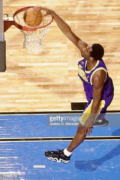 Kobe Bryant of the Western Conference AllStars dunks against the Eastern Conference AllStars during the 1998 NBA AllStar game played February 14 1998...