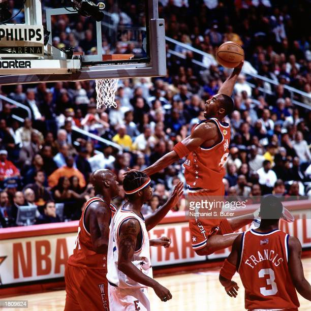 Kobe Bryant of the Western Conference AllStars soars in for a slam dunk against the Eastern Conference during the 52nd NBA AllStar Game at the...