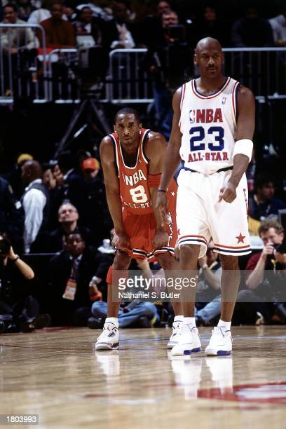 Kobe Bryant of the Western Conference AllStars takes a moment after playing against Michael Jordan of the Eastern Conference during the 52nd NBA...