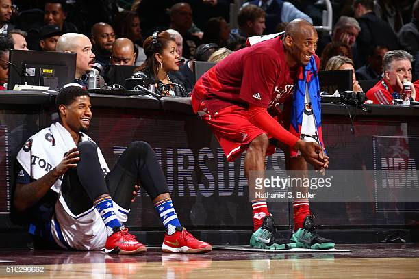 Kobe Bryant of the Western Conference and Paul George of the Eastern Conference smile as they wait to get in the game during the NBA AllStar Game as...