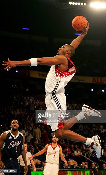 Kobe Bryant of the Western Conference dunks as Gilbert Arenas of the Eastern Conference looks on during the 2007 NBA AllStar Game on February 18 2007...
