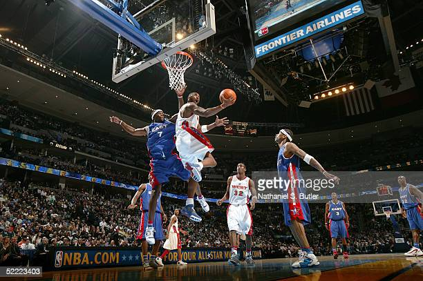 Kobe Bryant of the Western Conference goes for a reverse layup against Jermaine O'Neal of the Eastern Conference AllStars during the 2005 NBA AllStar...