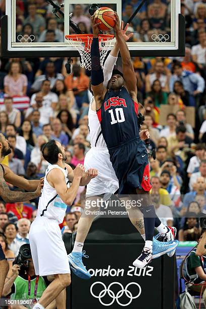 Kobe Bryant of United States dunks the ball over Andres Nocioni of Argentina in the first half during the Men's Basketball semifinal match on Day 14...