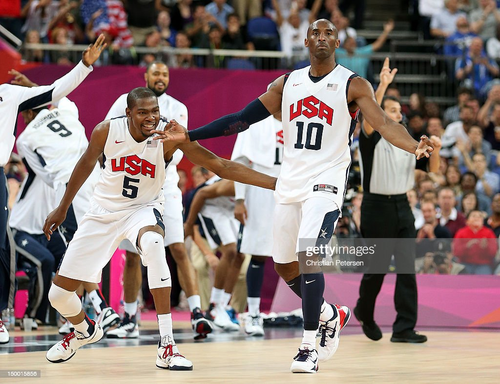 Kobe Bryant #10 of United States reacts with teammate Kevin Durant #5 after Bryant makes a three-pointer in the second half against Australia during the Men's Basketball quaterfinal game on Day 12 of the London 2012 Olympic Games at North Greenwich Arena on August 8, 2012 in London, England.