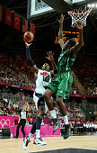 Kobe Bryant of United States shoots against AlFarouq Aminu of Nigeria in the first quarter during the Men's Basketball Preliminary Round match on Day...