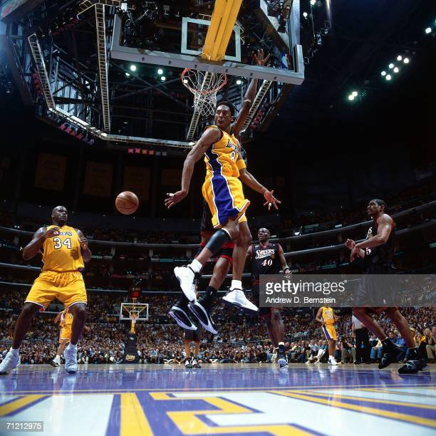 Kobe Bryant passes to teammate Shaquille O'Neal of the Los Angeles Lakers during Game one of the 2001 NBA Finals against the Philadelphia 76ers...