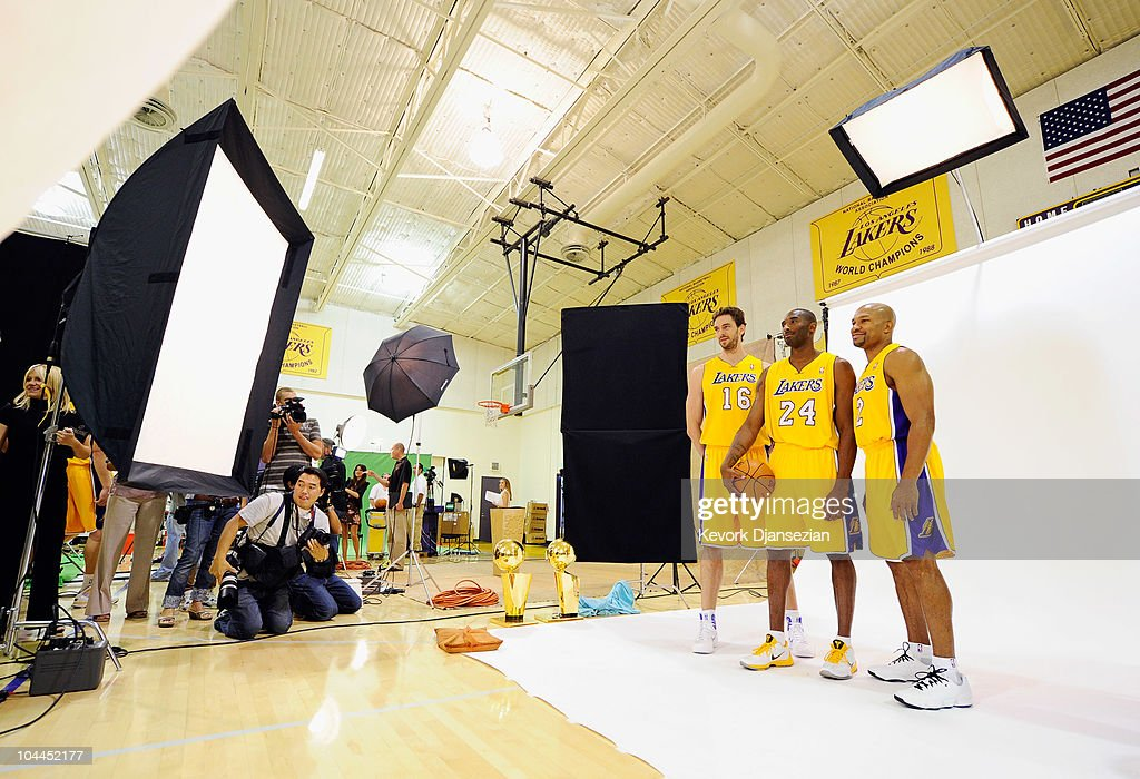 Kobe Bryant #24, Pau Gasol #16 and Derek Fisher #2 of the Los Angeles Lakers pose for a photograph during a Media Day at the Toyota Center on September 25, 2010 in El Segundo, California.