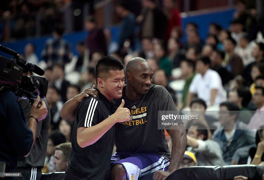 <a gi-track='captionPersonalityLinkClicked' href=/galleries/search?phrase=Kobe+Bryant&family=editorial&specificpeople=201466 ng-click='$event.stopPropagation()'>Kobe Bryant</a> poses for a picture with a fan at NBA Fan Appreciation day on October 17, 2013 in Shanghai, China.