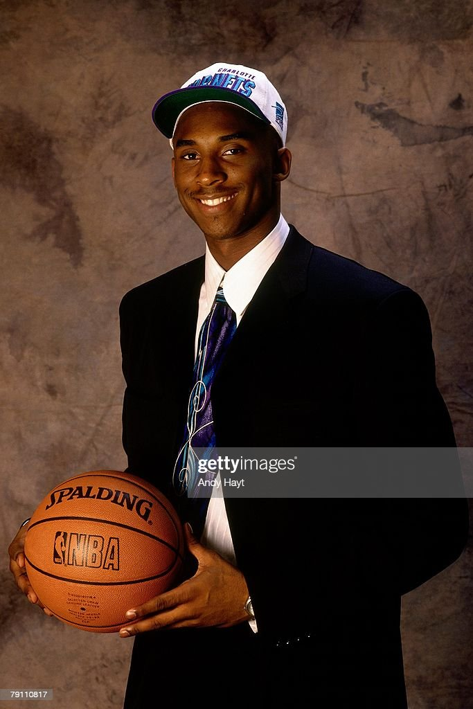 <a gi-track='captionPersonalityLinkClicked' href=/galleries/search?phrase=Kobe+Bryant&family=editorial&specificpeople=201466 ng-click='$event.stopPropagation()'>Kobe Bryant</a> poses for a portrait after being selected by the Charlotte Hornets in the first round of the 1996 NBA Draft on June 26, 1996 at Madison Square Garden in New York, New York.