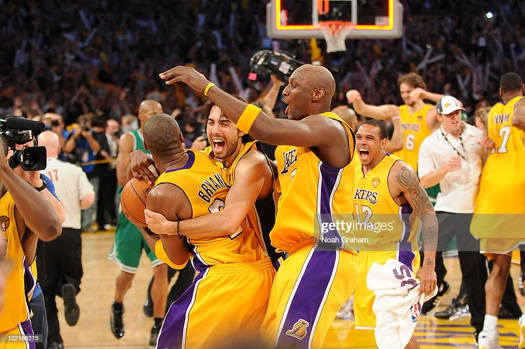 Kobe Bryant #24, Sasha Vujacic #18, Lamar Odom #7, and Shannon Brown #12 of the Los Angeles Lakers celebrate following their victory over the Boston Celtics in Game Seven of the 2010 NBA Finals on June 17, 2010 at Staples Center in Los Angeles, California.