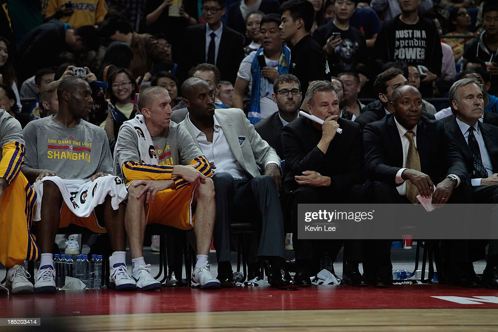 <a gi-track='captionPersonalityLinkClicked' href=/galleries/search?phrase=Kobe+Bryant&family=editorial&specificpeople=201466 ng-click='$event.stopPropagation()'>Kobe Bryant</a> sits with his team during the NBA match between the Los Angeles Lakers and the Golden State Warriors on October 18, 2013 in Shanghai, China.