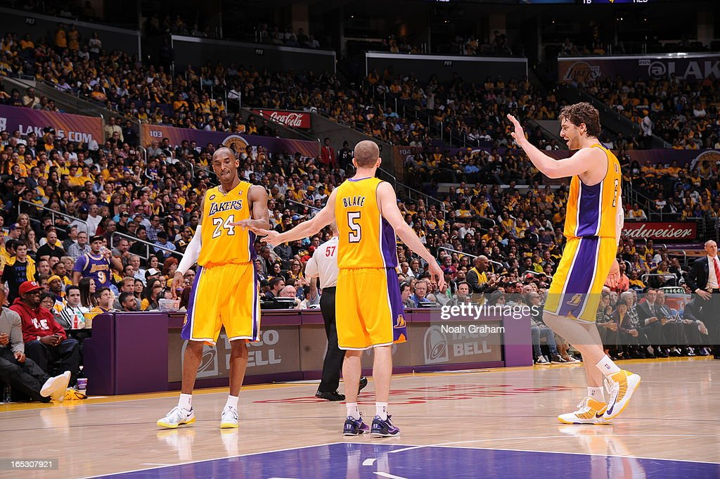 Kobe Bryant #24, Steve Blake #5, and Pau Gasol #16 of the Los Angeles Lakers celebrate in their game against the Dallas Mavericks at Staples Center on April 2, 2013 in Los Angeles, California.