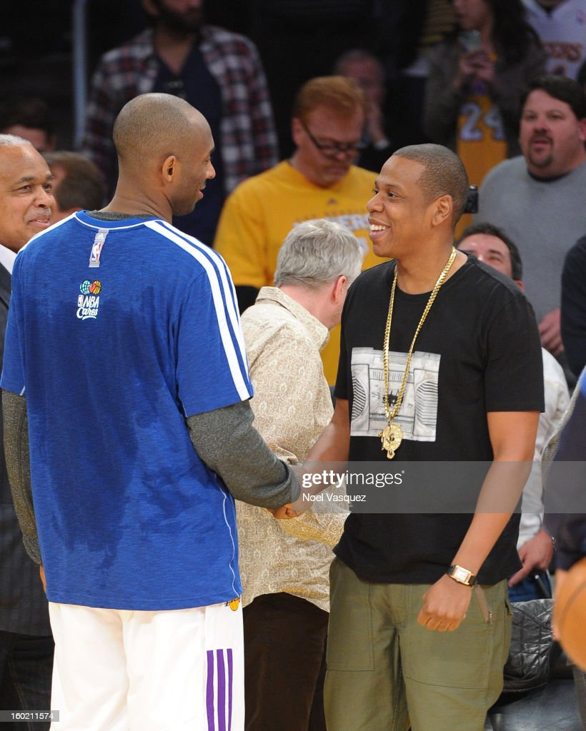 Kobe Bryant (L) talks to Jay Z at a basketball game between the Oklahoma City Thunder and the Los Angeles Lakers at Staples Center on January 27, 2013 in Los Angeles, California.