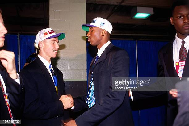 Kobe Bryant who was drafted number thirteen overall by the Charlotte Hornets and Steve Nash drafted number fifteen overall by the Phoenix Suns greet...