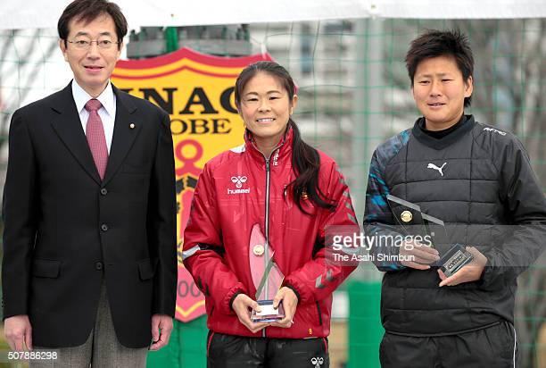 Kobe City Mayor Kizo Hisamoto Homare Sawa and Ayumi Kaihori pose after awarded the Kobe City Sports Special Contribution Prize during the INAC Kobe...