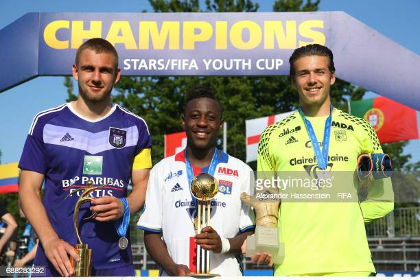 Kobe Cools of RSC Anderlecht Alan Dzabana of Olympique Lyonnais and Anthony Racioppi of Olympique Lyonnais pose with their awards following the Final...