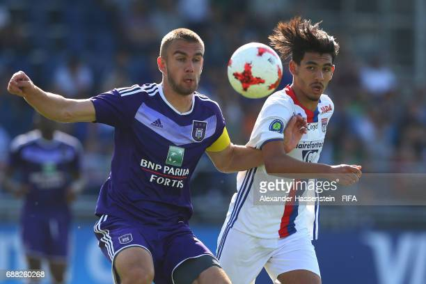 Kobe Cools of RSC Anderlecht and Mohamed Bahlhouli of Olympique Lyonnais compete for the ball during the Final match between Olympique Lyon vs RSC...