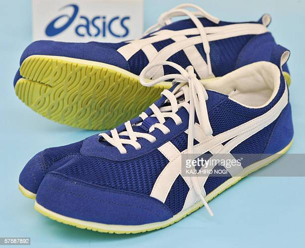 Picture shows the sample shoses featuring a twotoed shape made by Japanese sports shoes maker Asics at the company's head office in Kobe Hyogo...