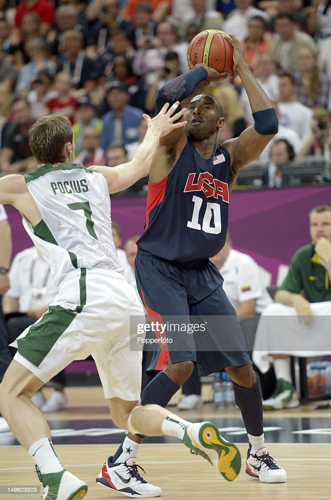 Kobe Jones of the United States watched by Martynas Pocius of Lithuania during the Men's Basketball Preliminary Round match United States v Lithuania on Day 8 of the London 2012 Olympic Games at the Basketball Arena on August 4, 2012 in London, England.
