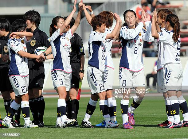 INAC Kobe Leonessa players celebrate their 32 win in the Nadeshiko League match between Urawa Red Diamonds and INAC Kobe Leonessa at Urawa Komaba...