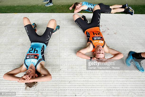 Kobe Mutch and Joshua Begley recover after the 3km time trail during the AFL Draft Combine on October 9 2016 in Melbourne Australia