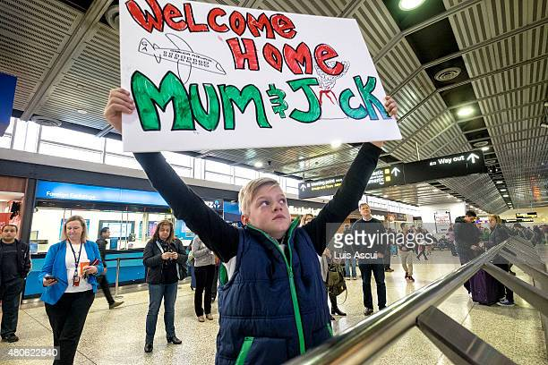 Kobe Rose waits for his mum's arrival at Melbourne International Airport on July 14 2015 in Melbourne Australia Flights to and from Bali were...