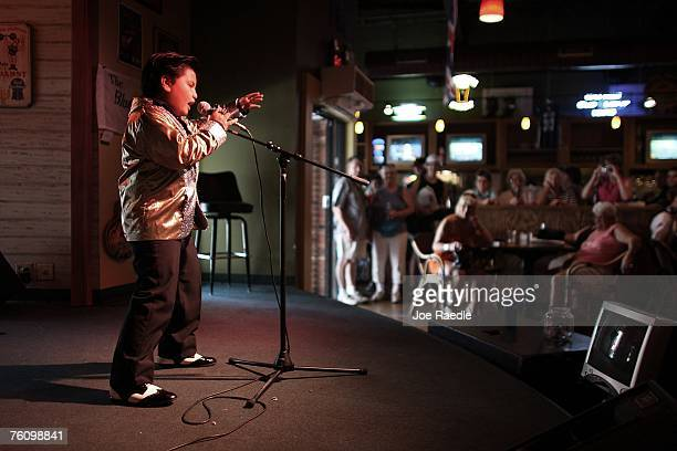 Kobe White from Melbourne Australia belts out an Elvis Presley tune as he does an impersonation act August 14 2007 in Memphis Tennessee This week...