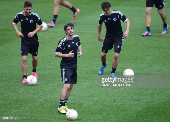Kobenhavn's midfielder Martin Vingaard Kobenhavn's midfielder César Santin and Kobenhavn's midfielder Thomas Delaney warm up during the official...