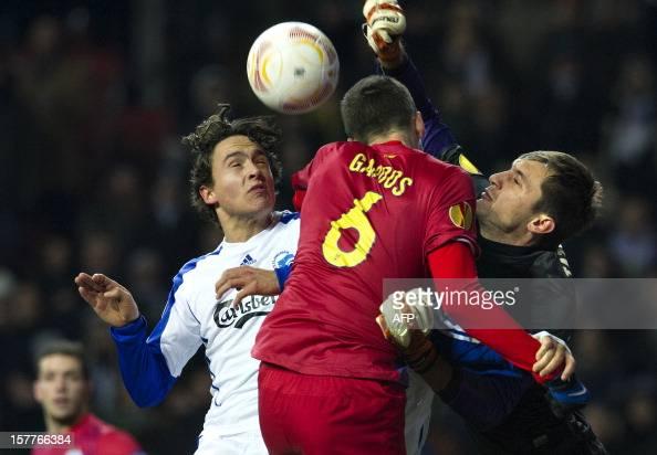 Kobenhavn's midfielder Thomas Delaney vies for the ball with Bucharest's defender Florin Gardos and Bucharest's goalkeeper Ciprian Tatarusanu during...