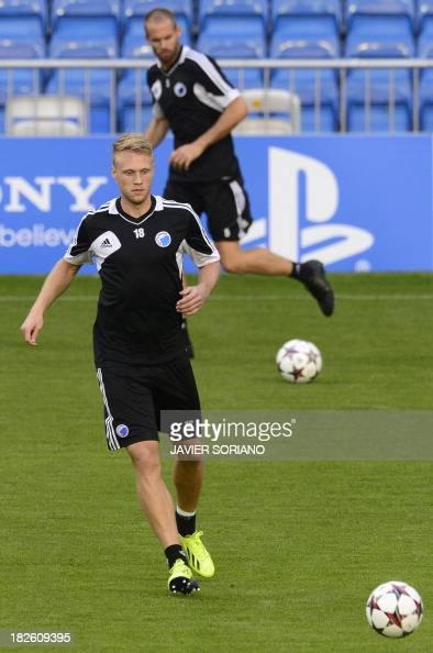 Kobenhavn's striker Nicolai Jorgensen and Kobenhavn's midfielder Thomas Delaney practice during a training session at the Santiago Bernabeu stadium...