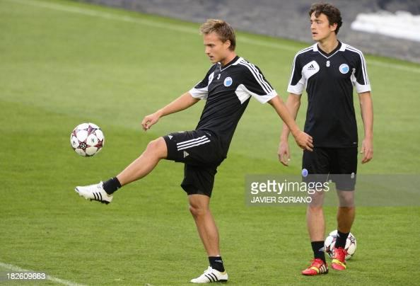 Kobenhavn's Swedish defender Pierre Bengtsson and Kobenhavn's midfielder Thomas Delaney practice during a training session at the Santiago Bernabeu...