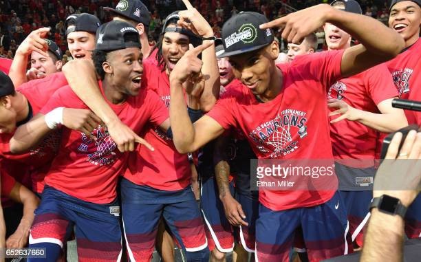 Kobi Simmons Keanu Pinder and Allonzo Trier of the Arizona Wildcats celebrate after defeating the Oregon Ducks 8380 to win the championship game of...
