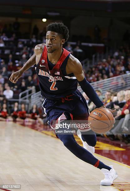 Kobi Simmons of the Arizona Wildcats handles the ball against the USC Trojans during NCAA Pac12 conference college basketball game at Galen Center on...